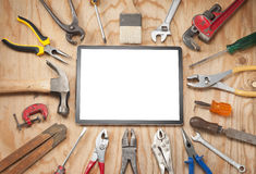tools-tablet-background-computer-surrounded-hand-wood-59114514[1]