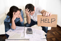 young-couple-worried-home-bad-financial-situation-stress-asking-help-need-couch-accounting-debt-bills-bank-papers-47624899[1]