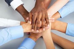 business-team-closeup-putting-their-hands-top-each-other-31468245[1]